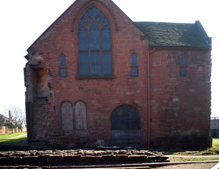East end of cloister building with foundations of church in foreground