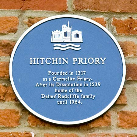 Blue badge (the priory was suppressed in 1538 and rented for use as a school by Ralph Radcliffe)